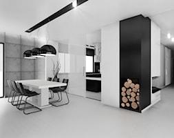 Czarno na białym - Średnia otwarta biała czarna jadalnia w salonie, styl minimalistyczny - zdjęcie od Manufaktura Studio grupa projektowa