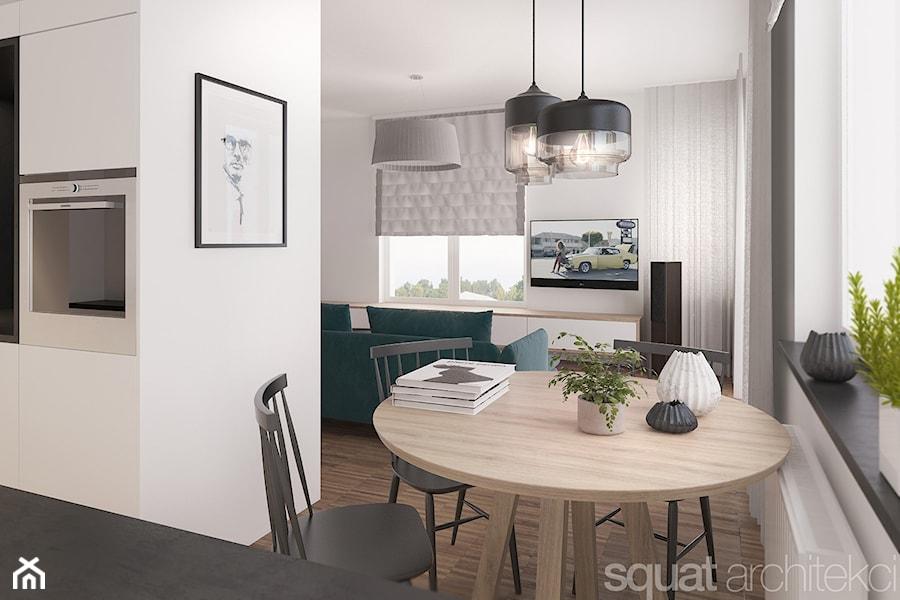 MIESZKANIE W ŁODZI 75m2 - Mała otwarta biała jadalnia w kuchni w salonie, styl nowoczesny - zdjęcie od squat architekci