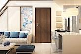 Drzwi w kolorze ciemnego drewna, beżowe ściany w salonie