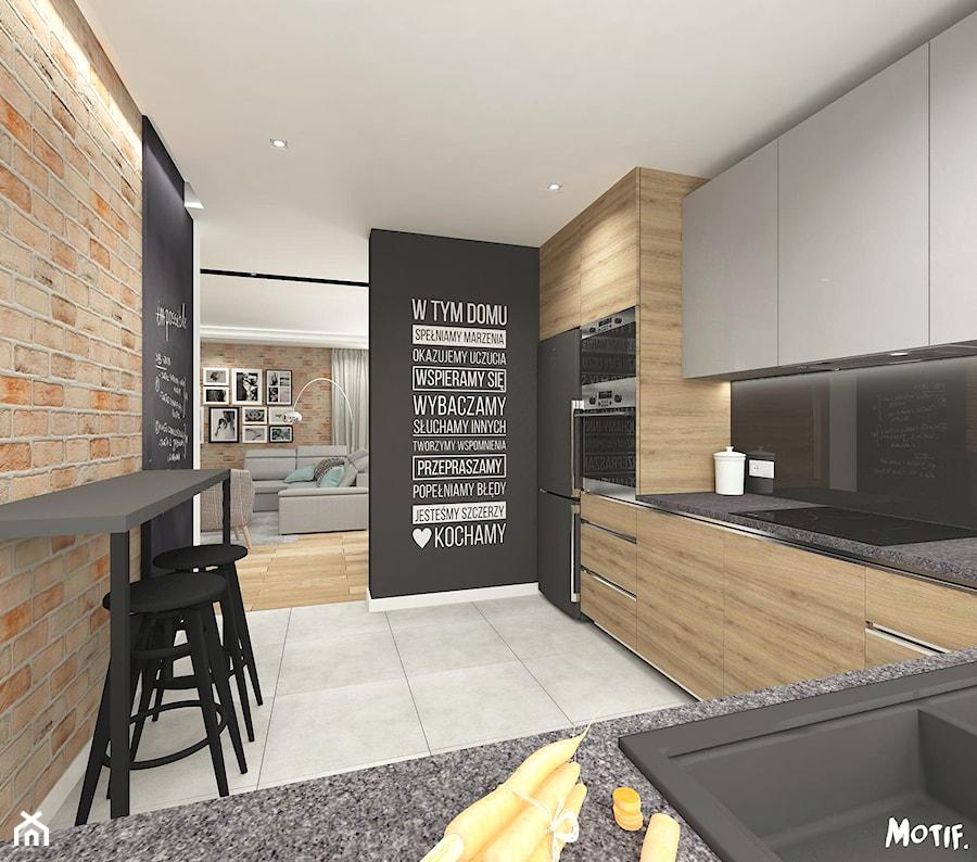 Przytulny Salon Z Kominkiem Oraz Kuchnia Srednia Otwarta Czarna