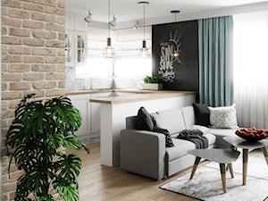 Mieszkanie w Legnicy - Mały szary czarny salon z kuchnią z jadalnią, styl skandynawski - zdjęcie od Pracownia WAŻKA
