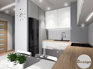 Biało- szare mieszkanie, Warszawa - Mała otwarta szara kuchnia w kształcie litery u, styl minimalistyczny - zdjęcie od exDesign Ewelina Stępień-Chojnacka