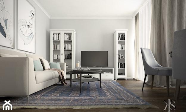 mieszkanie z drewnianą podłogą i dywanem