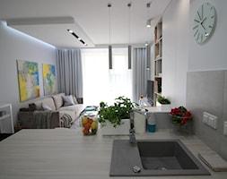 Eleganckie, nowoczesne, jasne mieszkanie w apartamentowcu - Średni biały salon z bibiloteczką z kuchnią z tarasem / balkonem, styl nowoczesny - zdjęcie od MK HOME