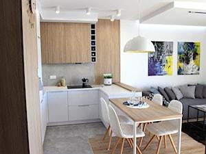 Nowoczesne mieszkanie w apartamentowcu, biel i szarość ocieplane drewnem