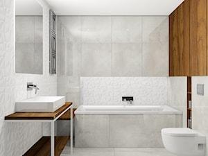 łazienka z płytkami 3D oraz  imitacją polerowanego betonu