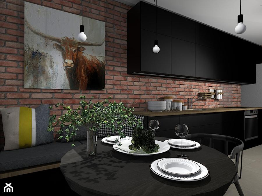 Kuchnia z jadalnią wykończona cegłą rozbiórkową - zdjęcie od FEDER