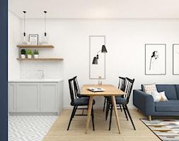 Mieszkanie 43m2 Warszawa - Średnia otwarta biała jadalnia w kuchni w salonie, styl skandynawski - zdjęcie od INTERIOLOGY - Homebook