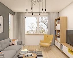 Mieszkanie 47m2 Warszawa - Średni szary beżowy salon z bibiloteczką, styl skandynawski - zdjęcie od INTERIOLOGY