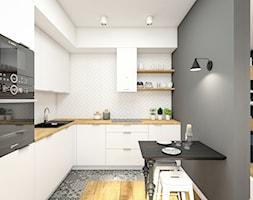 Mieszkanie 70m2 Warszawa - Mała średnia otwarta biała szara kuchnia w kształcie litery l, styl skandynawski - zdjęcie od INTERIOLOGY