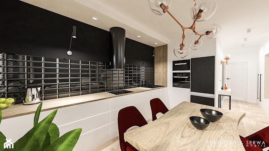 Mieszkanie w Wilanowie - Duża otwarta biała czarna kuchnia w kształcie litery l, styl nowoczesny - zdjęcie od Piwońska&Serwa