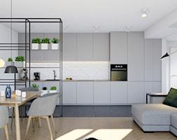 Pomysłowe wnętrze szeregówki - Średnia otwarta szara kuchnia jednorzędowa w aneksie, styl minimalis ... - zdjęcie od NUKO STUDIO - Homebook