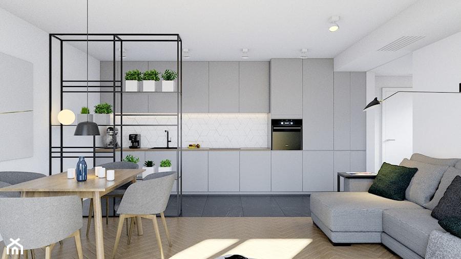 Pomysłowe wnętrze szeregówki - Średnia otwarta szara kuchnia jednorzędowa w aneksie, styl minimalis ... - zdjęcie od NUKO STUDIO