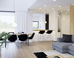 Przytulne wnętrze - Duża otwarta biała beżowa jadalnia w salonie, styl nowoczesny - zdjęcie od NUKO STUDIO - Homebook