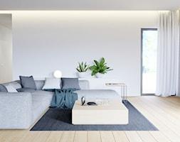 Eleganckie wnętrze - Duży biały salon z tarasem / balkonem, styl nowoczesny - zdjęcie od NUKO STUDIO - Homebook