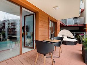Design - Średni taras z przodu domu z tyłu domu - zdjęcie od Apartments M&M- obsługa i aranżacja nieruchomości