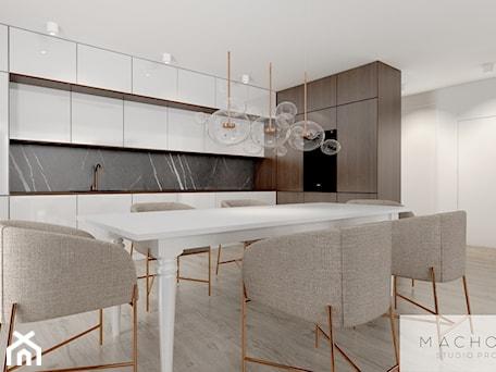 Aranżacje wnętrz - Kuchnia: Elegancja w nowoczesnym wydaniu - kuchnia z jadalnią - Machowska Studio Projektowe. Przeglądaj, dodawaj i zapisuj najlepsze zdjęcia, pomysły i inspiracje designerskie. W bazie mamy już prawie milion fotografii!
