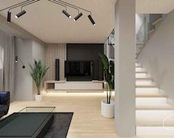 Salon w kontrastowych kolorach, ścianka TV, podświetlane schody - zdjęcie od Pracownia wnętrz Onyks Anna Oniszk-Popławska