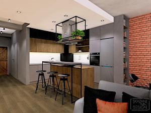 MIESZKANIE RUDA ŚLĄSKA STREFA DZIENNA - Średnia biała czarna kuchnia w kształcie litery l w aneksie z wyspą, styl industrialny - zdjęcie od SKAZANI NA DESIGN Studio Architektury