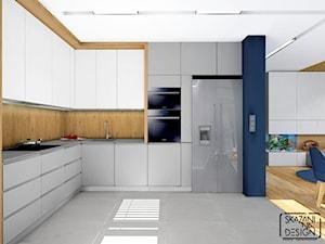 MIESZKANIE GLIWICE I - Duża otwarta beżowa niebieska kuchnia w kształcie litery l, styl nowoczesny - zdjęcie od SKAZANI NA DESIGN Studio Architektury