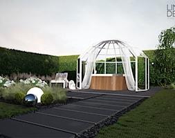 Projekt ogrodu przydomowego w Solcu - Średni ogród za domem z jacuzzi, styl nowoczesny - zdjęcie od Line Design