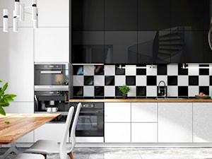 Nowoczesna czarno-biała kuchnia a w niej okap kuchenny Hadario 60 White
