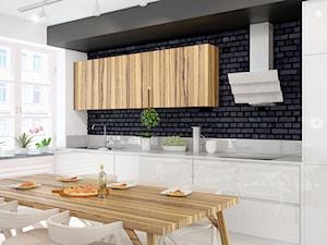 Minimalistyczna zabudowa kuchenna wraz ze szklanym okapem Divergo White, połączona z jadalnią
