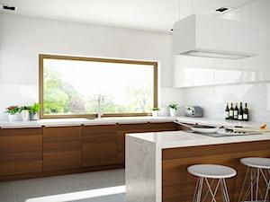 Biel i drewno w nowoczesnej kuchni otwartej na salon z okapem Tudara White