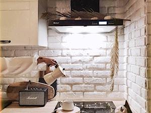 Projekt klasycznej białej kuchni z okapem Nomina Black