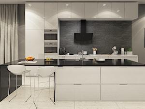 Kuchnia z betonem architektonicznym, elegancką wyspą i okapem Vintio Black