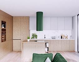 Kuchnia otwarta na salon z okapem Cylindro Isola Green - zdjęcie od GLOBALO.PL - Ciche i wydajne okapy kuchenne - Homebook