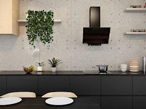 Szklany okap Divergo Black w nowoczesnej minimalistycznej kuchni z betonem architektonicznym