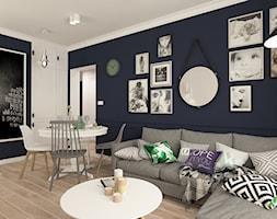 Salon+-+zdj%C4%99cie+od+MONTO+lustra+w+sk%C3%B3rzanej+oprawie