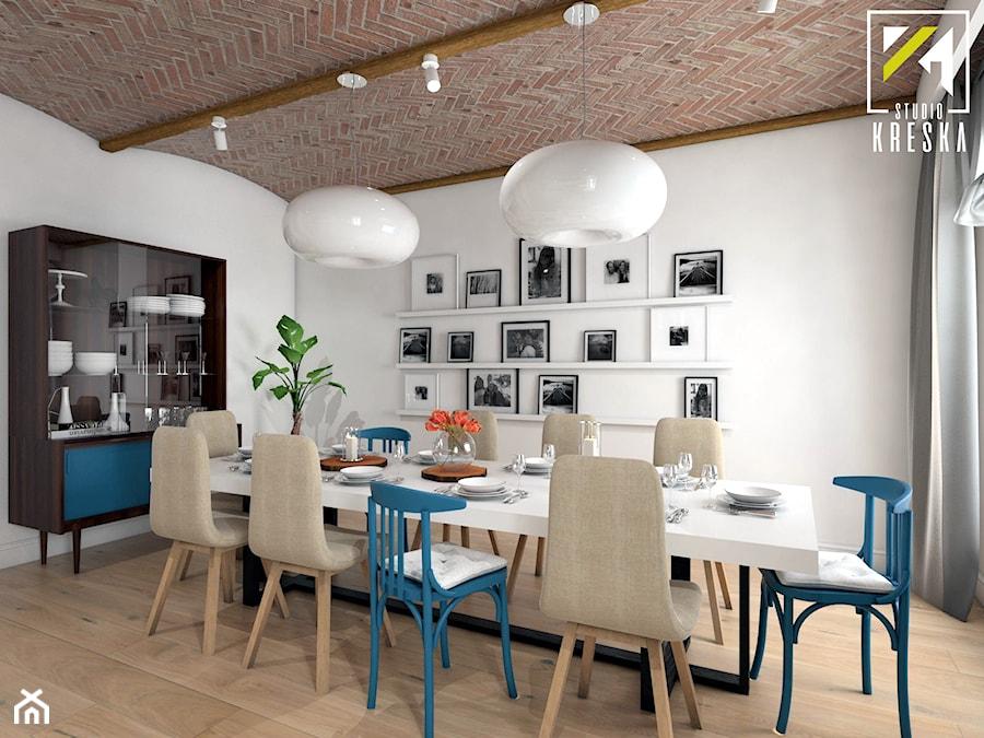 Projekt aranżacji wnętrz domu parterowego w Gostyniu pod Głogowem - Średnia zamknięta szara jadalnia jako osobne pomieszczenie - zdjęcie od kreska.studio