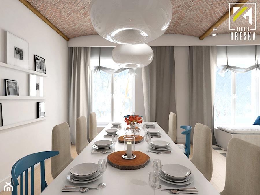 Projekt aranżacji wnętrz domu parterowego w Gostyniu pod Głogowem - Duża otwarta biała jadalnia w salonie - zdjęcie od kreska.studio
