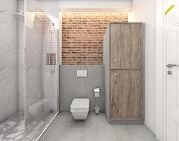 Projekt aranżacji wnętrz domu parterowego w Gostyniu pod Głogowem - Średnia szara łazienka na poddaszu w bloku w domu jednorodzinnym bez okna - zdjęcie od kreska.studio