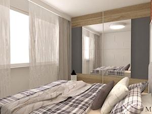 Sypialnia z czerwowną cegłą