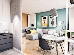 PROJEKT MIESZKANIA 46 m2-Wawa 2018 - Mała otwarta zielona jadalnia w salonie, styl skandynawski - zdjęcie od BIBI