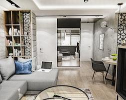 Projekt mieszkania - Gdańsk 2019 r. - Średni biały salon z bibiloteczką z jadalnią, styl nowoczesny - zdjęcie od BIBI