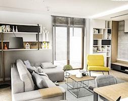 Projekt Mieszkania W-wa 2019 - Średni szary salon z bibiloteczką - zdjęcie od BIBI