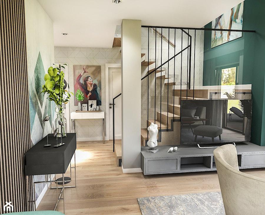 Projekt wnętrza domu pod Sewillą - Mały zielony salon z tarasem / balkonem - zdjęcie od BIBI