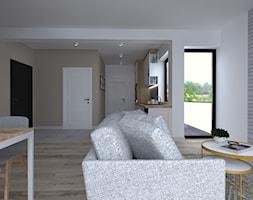 Aranżacja mieszkania - Mały szary biały brązowy salon z kuchnią z jadalnią, styl skandynawski - zdjęcie od IN DESIGN STUDIO