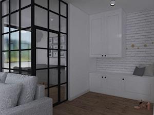 Aranżacja mieszkania - Mały biały hol / przedpokój, styl skandynawski - zdjęcie od IN DESIGN STUDIO