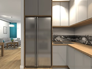 Mieszkanie 84m2 Warszawa - Wilanów - Mała otwarta szara kuchnia w kształcie litery l, styl nowoczesny - zdjęcie od Medyńscy Projektowanie