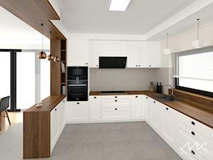 Projekt wnętrz domu w Łuczycach - Duża biała szara kuchnia w kształcie litery u w aneksie z wyspą z oknem, styl tradycyjny - zdjęcie od mleczko architektura