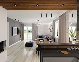 Dom w Różynach - Duży szary salon z kuchnią z jadalnią, styl nowoczesny - zdjęcie od Pracownia Projektowa Decoretti - Agata Jachimowicz - Homebook