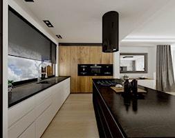 Dom w Smęgorzynie - Duża otwarta biała kuchnia w kształcie litery l z wyspą z oknem, styl nowoczesny - zdjęcie od Pracownia Projektowa Decoretti - Agata Jachimowicz