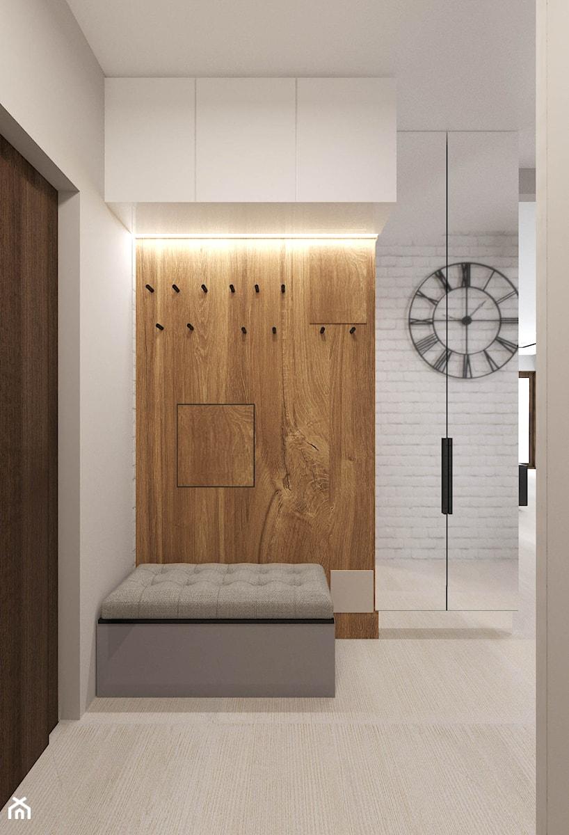Apartament Morena - Metamorfoza - Średni biały hol / przedpokój, styl nowoczesny - zdjęcie od Pracownia Projektowa Decoretti - Agata Jachimowicz