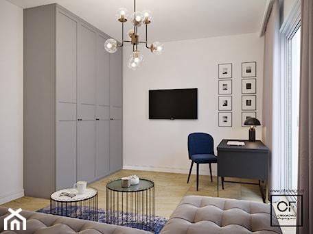 Aranżacje wnętrz - Biuro: Eleganckie wnętrza w domu jednorodzinnym - Średnie białe biuro domowe kącik do pracy w pokoju, styl art deco - O.Fiedorowicz . Przeglądaj, dodawaj i zapisuj najlepsze zdjęcia, pomysły i inspiracje designerskie. W bazie mamy już prawie milion fotografii!