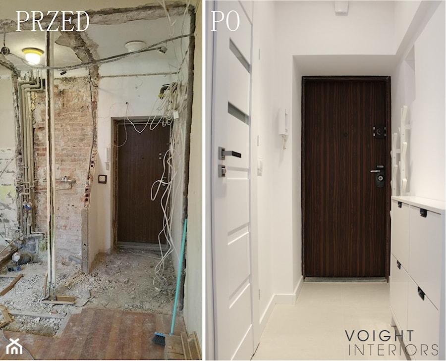 Zdjęcia z metamorfozy mieszkania 36m2 w Warszawie - Średni biały hol / przedpokój, styl skandynawsk ... - zdjęcie od Voight Interiors